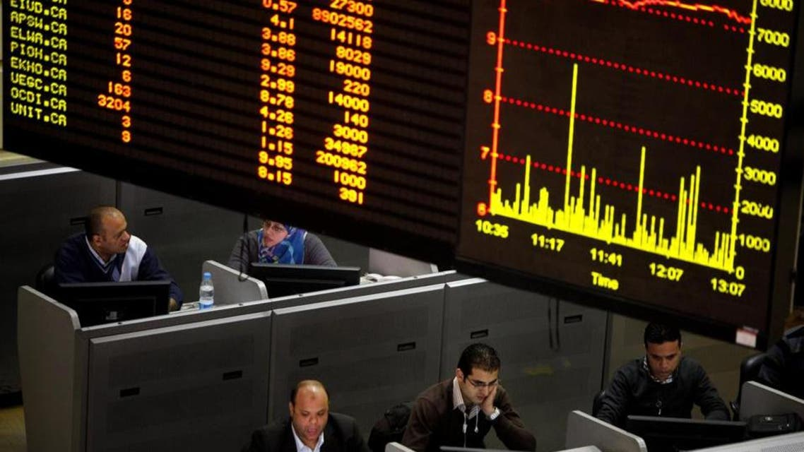 Egyptian traders work at the stock market in Cairo, Egypt. (Photo courtesy: AP)