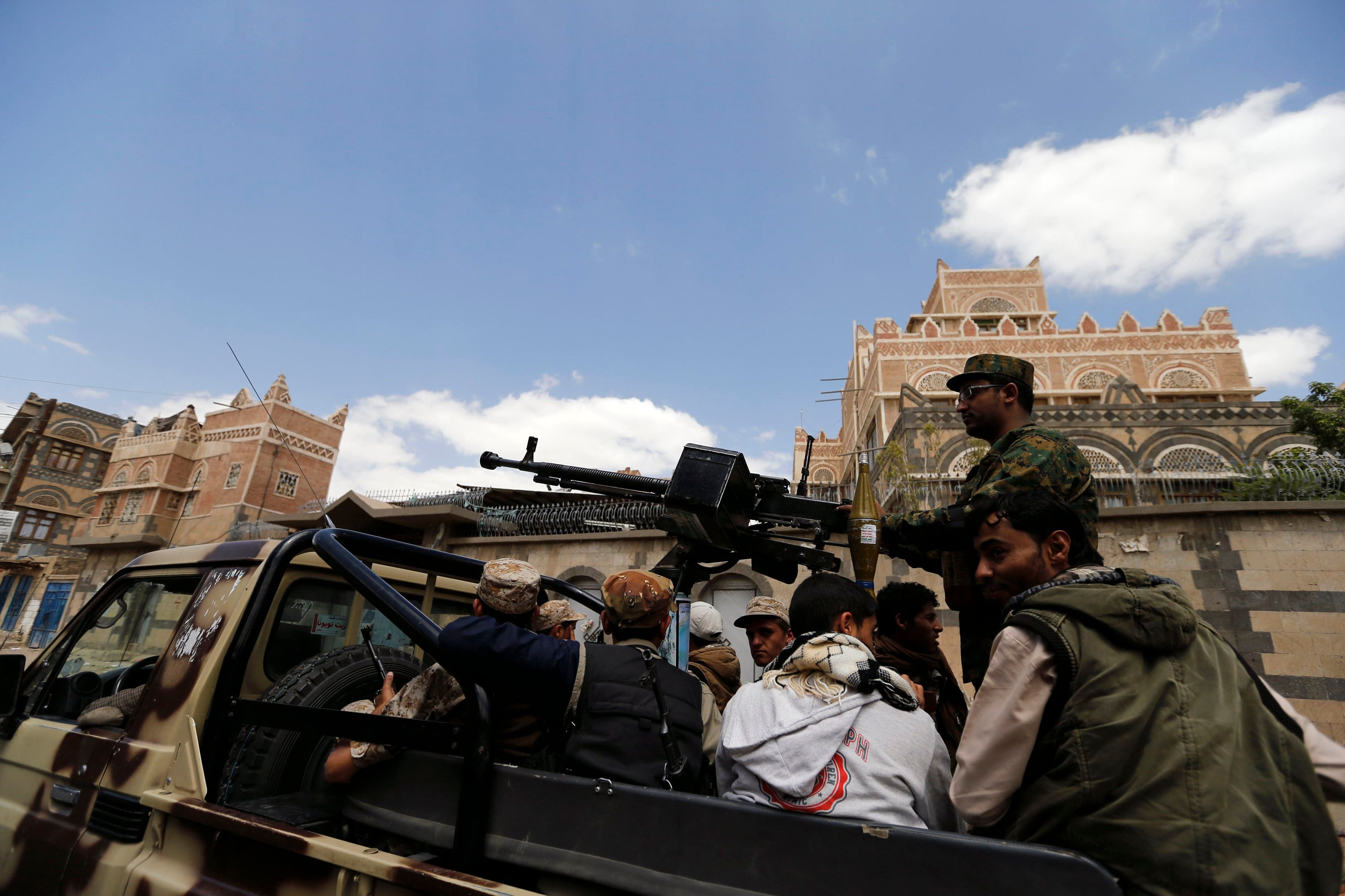 Shi'ite Houthi militants patrol the vicinity of a venue where a mass funeral for victims of a suicide attack on followers of the Shi'ite Houthi group was being held in Sanaa October 14, 2014. (Reuters)