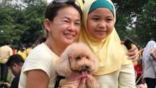 'Dog patting' event upsets Malaysian clerics