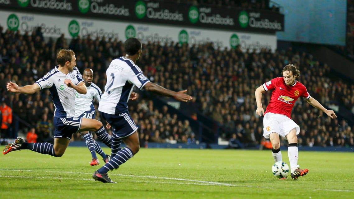 Daley Blind of Manchester United shoots to score against West Bromwich Albion during their English Premier League soccer match at The Hawthorns in West Bromwich October 20, 2014. (Reuters)