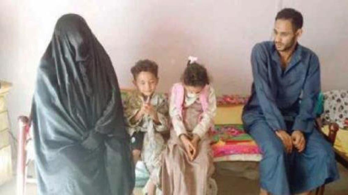 Um Hasan with some of her children, including her elder son. — Courtesy Al-Hayat