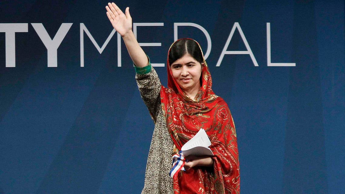 Malala Yousafzai of Pakistan, who was awarded the 2014 Liberty Medal, acknowledges the applause of the audience at the conclusion of the ceremony at the National Constitution Center in Philadelphia, Pennsylvania October 21, 2014. (Reuters)