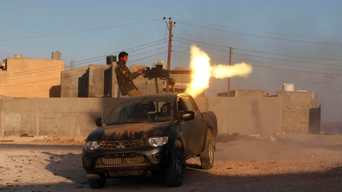 A fighter from armed group Operation Dawn fires a weapon during clashes with rival group the Zintan brigade, on the outskirts of the city of Kklh, southwest of Tripoli Oct. 21, 2014. (Reuters)