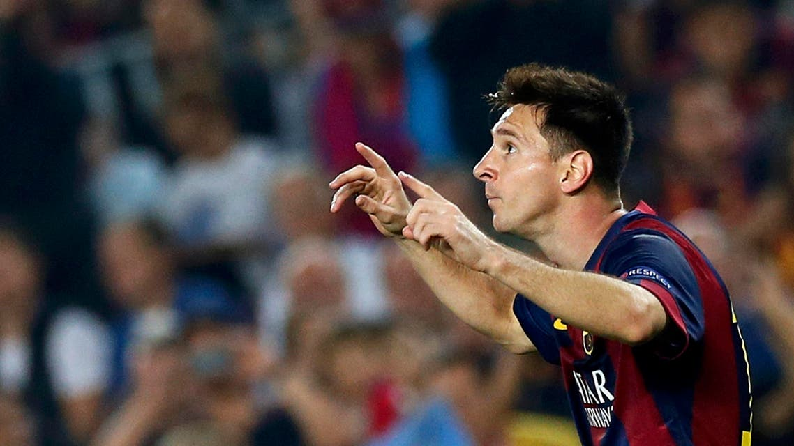 Barcelona's Lionel Messi celebrates after scoring a goal against Ajax Amsterdam during their Champions League soccer match at Camp Nou stadium in Barcelona October 21, 2014. (Reuters)