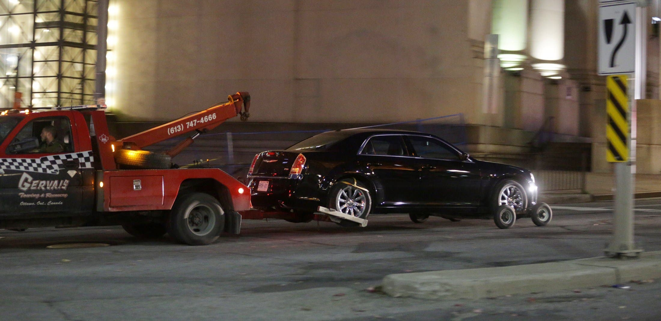 A Chrysler vehicle is towed away from Parliament Hill on October 22, 2014 in Ottawa, Canada.