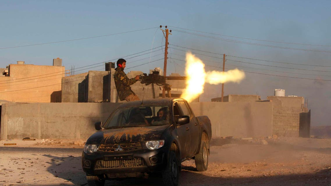 A fighter from armed group Operation Dawn fires a weapon during clashes with rival group the Zintan brigade, on the outskirts of the city of Kklh, southwest of Tripoli October 21, 2014.  (Reuters)