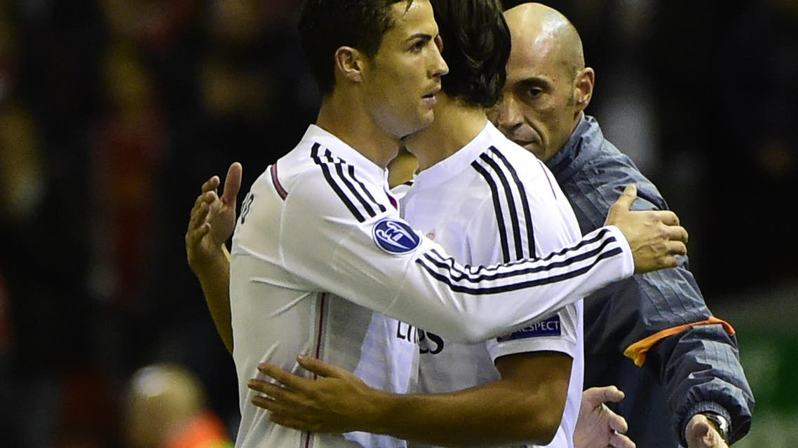Real Madrid's Portuguese forward Cristiano Ronaldo (L) embraces Real Madrid's German midfielder Sami Khedira (R) as he is substituted during the UEFA Champions League, group B, football match between Liverpool and Real Madrid at Anfield in Liverpool, northwest England, on October 22, 2014. AFP