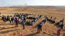 Turkey to allow 200 Iraqi Kurds to cross into embattled Kobane