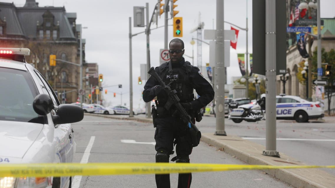 n Ottawa police officer stands guard on Wellington St. after a shooting occurred at the National War Memorial near the Canadian Parliament October 22, 2014 in Ottawa, Canada.