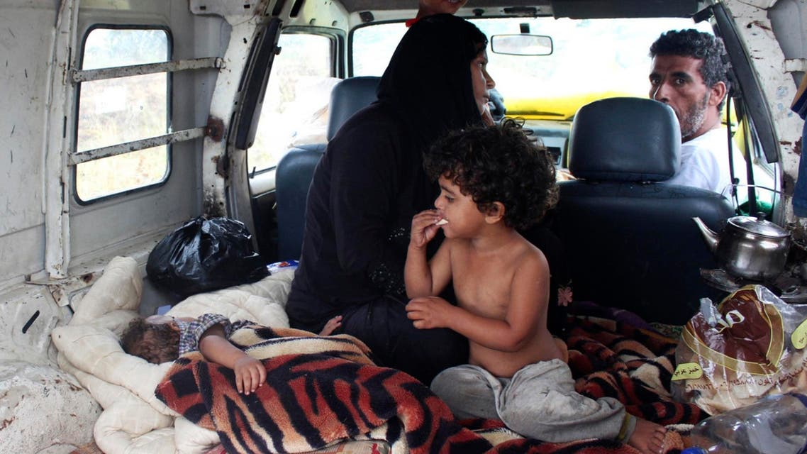 yrian refugees take shelter inside a van after their makeshift tent was damaged by heavy rain in Halba, northern Lebanon, Sept. 28, 2014. (AFP)