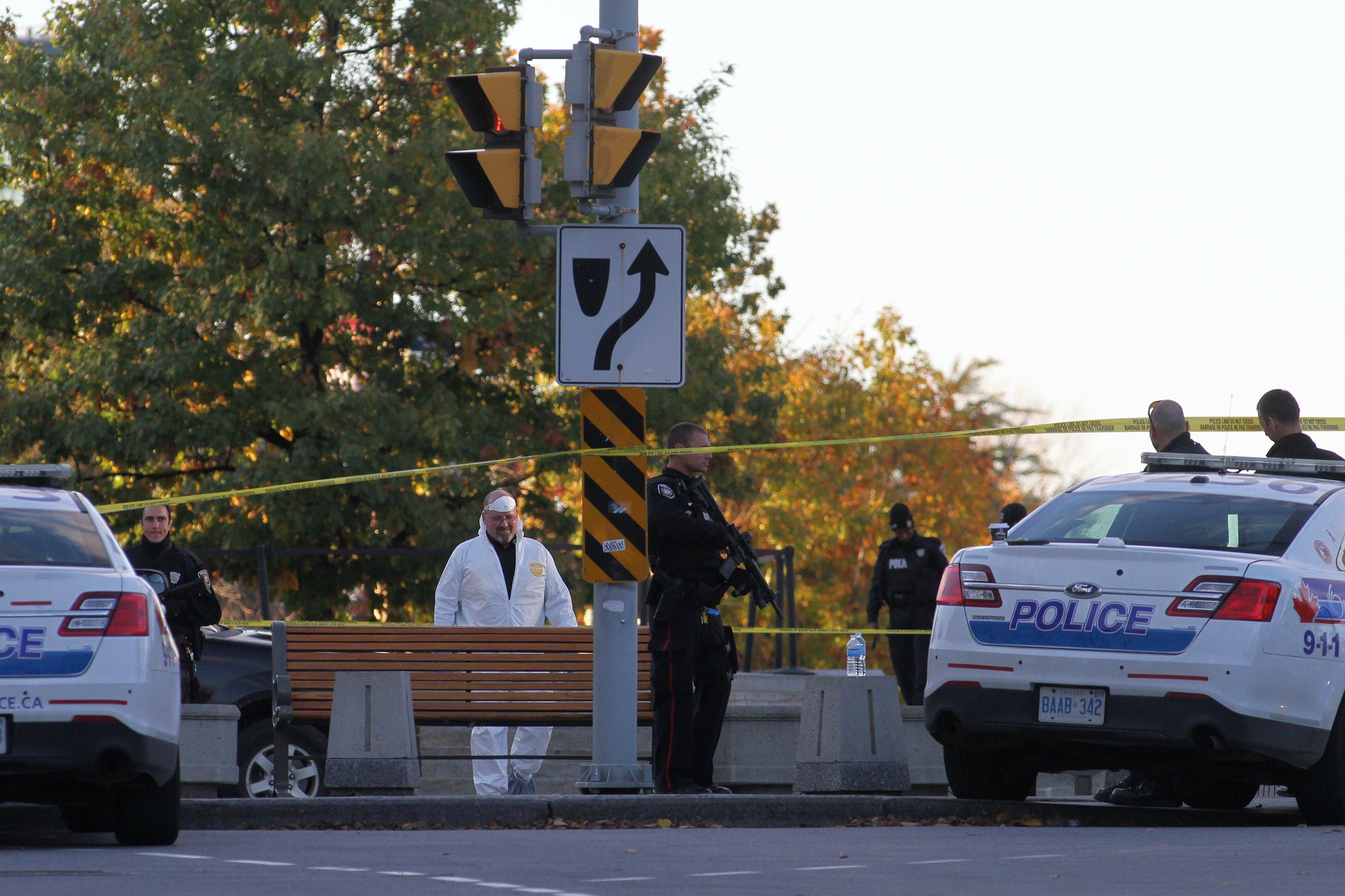Forensic police officers work near the National War Memorial in Ottawa, Canada on Wednesday October 22, 2014.