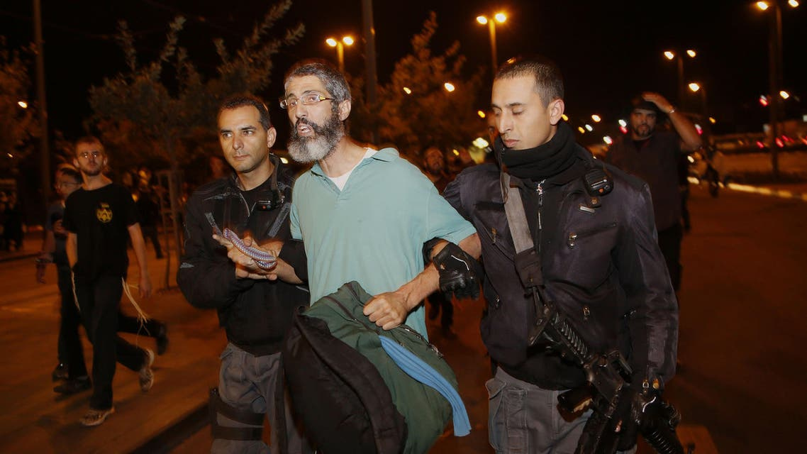 Israeli police detain a right wing protestor during a demonstration on October 23, 2014 in Jerusalem, a day after a Palestinian driver ran over a crowded tram station. (Reuters)