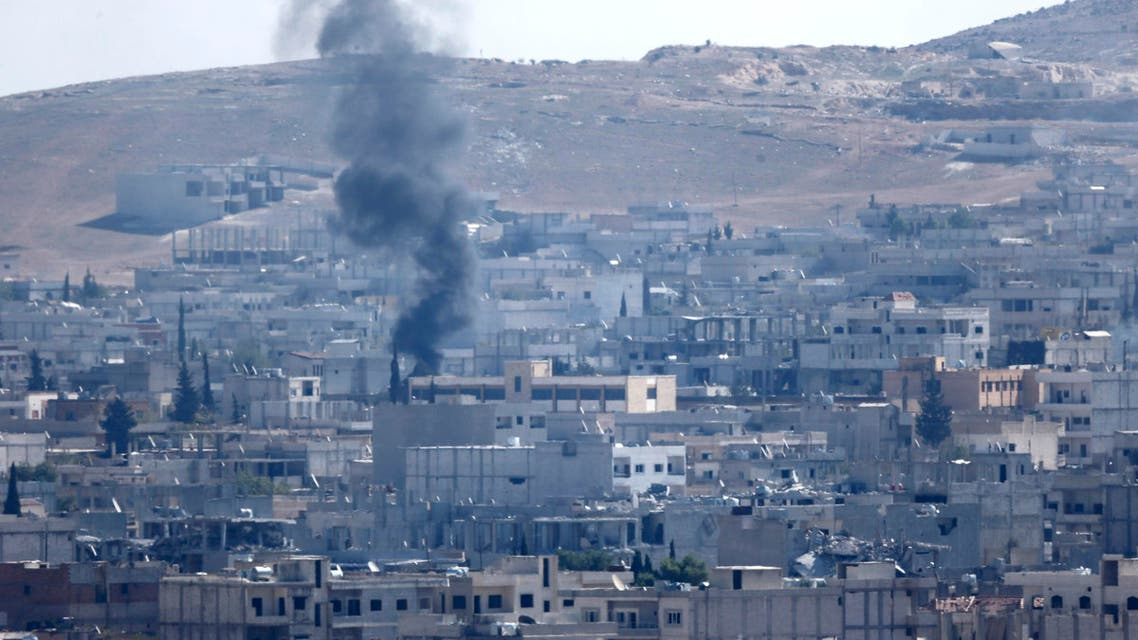 Smoke rises over the Syrian town of Kobane near the Mursitpinar border crossing, on the Turkish-Syrian border, as seen from the southeastern town of Suruc in Sanliurfa province October 24, 2014. (Reuters)