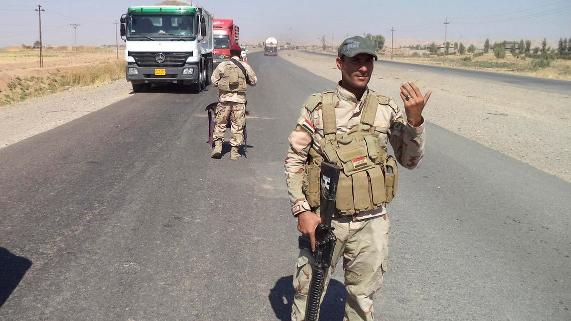 raqi soldiers stand guard at a checkpoint on the outskirts of Tikrit, northern Iraq October 8, 2014. Picture taken Oct. 8, 2014.  (AFP)