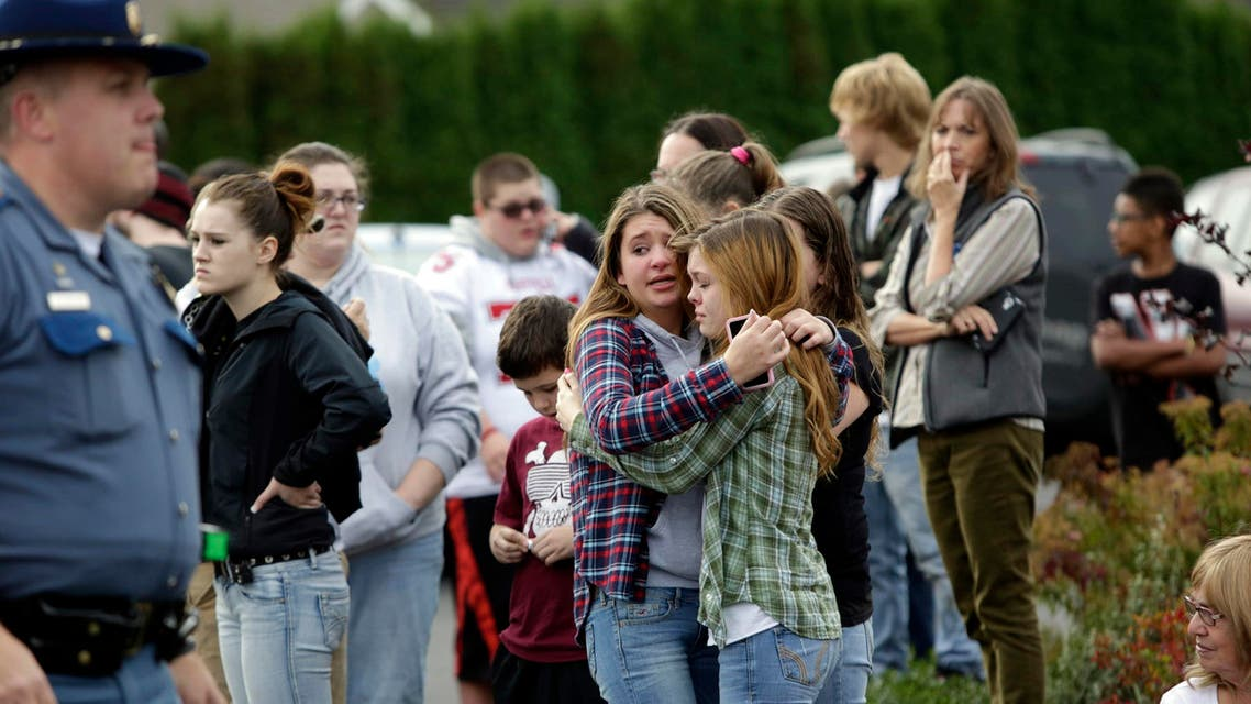 Two girls hug at Shoultes Gospel Hall church where families are reuniting after an active shooter situation at Marysville-Pilchuck High School in Marysville, Washington October 24, 2014.