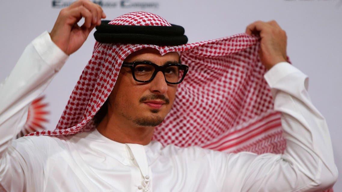 Emirati director Ali Mostafa, director of film from A to B adjusts his head scarf, at the opening of 8th edition of the Abu Dhabi Film Festival (ADFF), in Abu Dhabi on October 23, 2014.  (AFP)