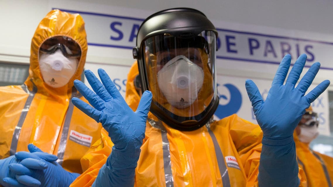 Staff of the emergency medical services in France (SAMU) wear Ebola virus protection outfits during a press presentation at the Necker Hospital in Paris, October 24, 2014. (Reuters)