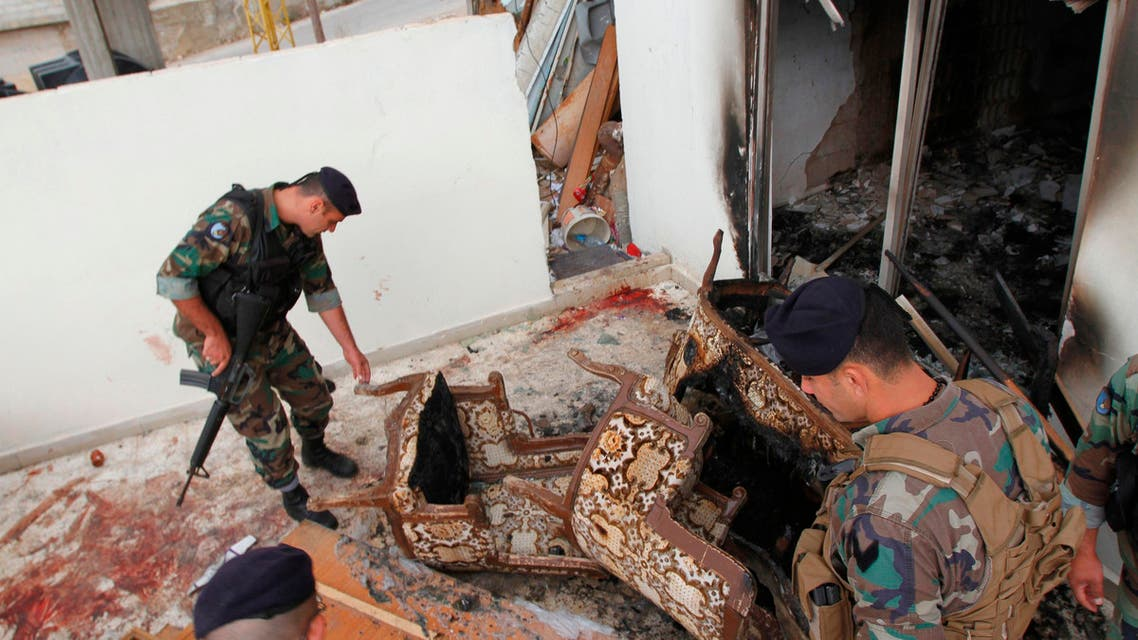 Lebanese army soldiers inspect the damage as bloodstains are seen on the floor following a raid on an apartment, in the northern town of Asoun October 23, 2014. (Reuters)