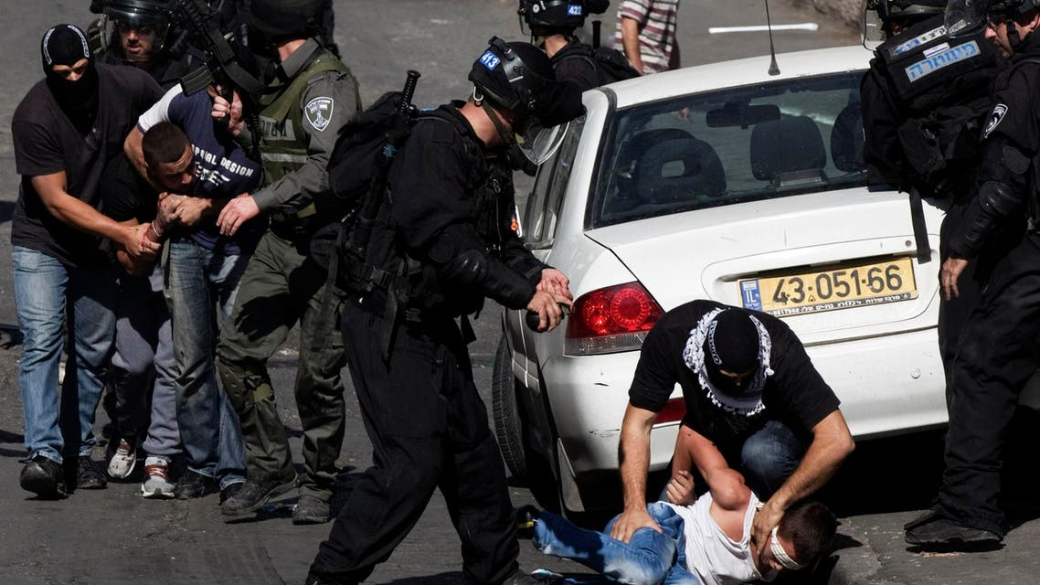 Israeli police officers detain Palestinians following clashes after Friday prayers in the East Jerusalem neighbourhood of Wadi al-Joz October 24, 2014. (Reuters)