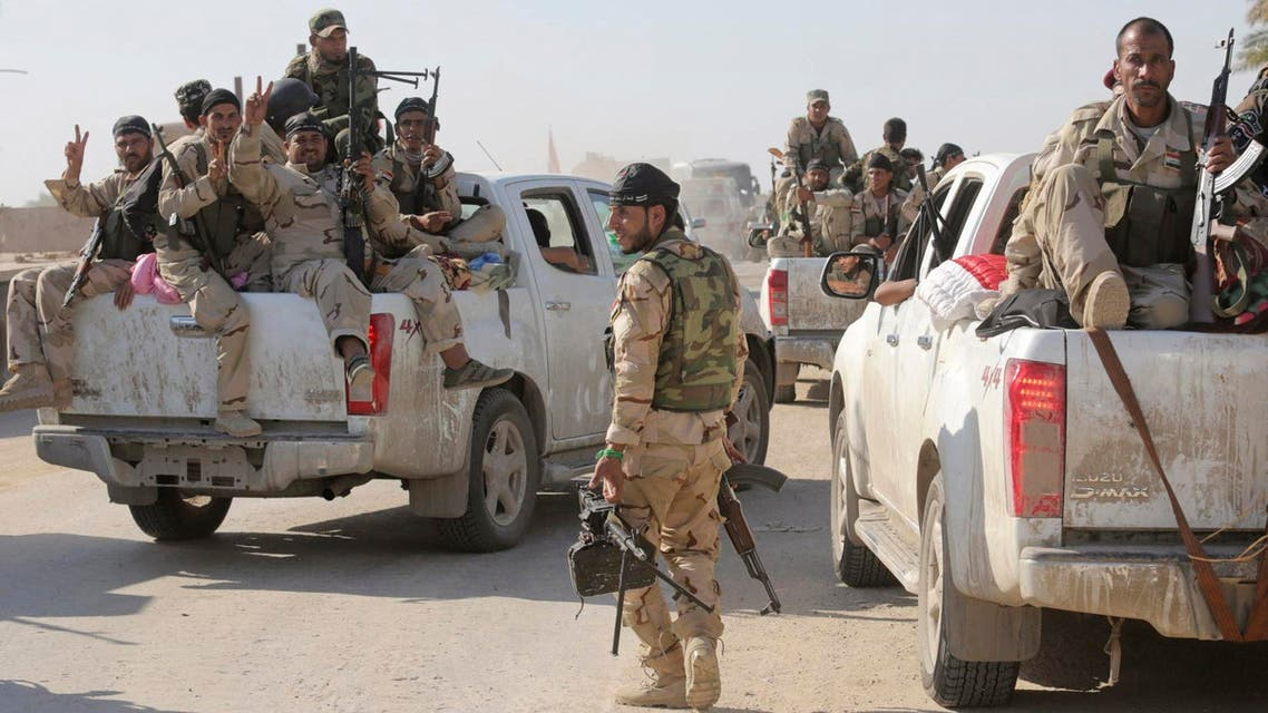 Fighters and Iraqi army members ride in vehicles during a patrol in Jurf al-Sakhar October 25, 2014. (Reuters)