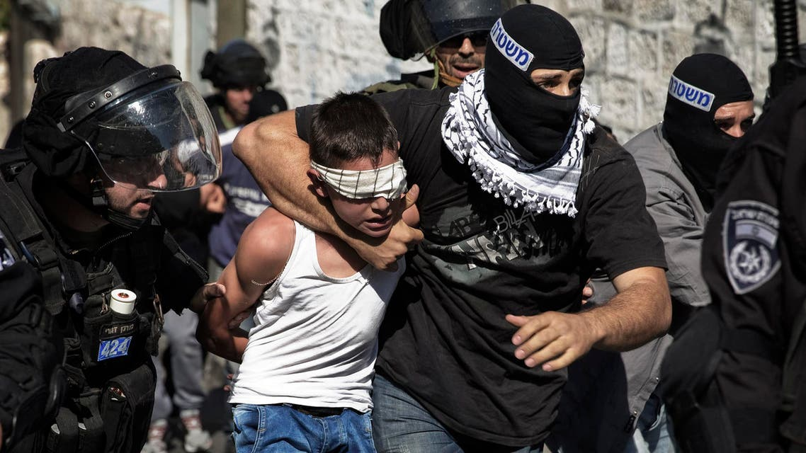 Israeli police detain a Palestinian youth following clashes after Friday prayers in the East Jerusalem neighbourhood of Wadi al-Joz October 24, 2014. (Reuters)