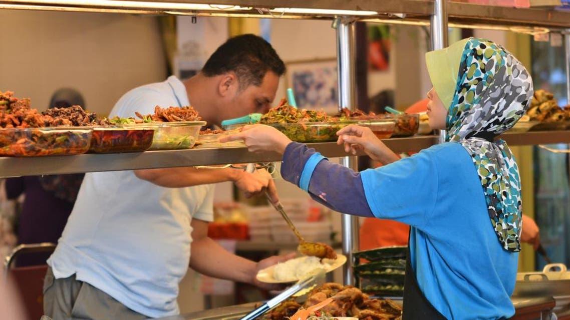 Muslim lady preparing halal food in Malacca, Malaysia. (File photo: Shutterstock)