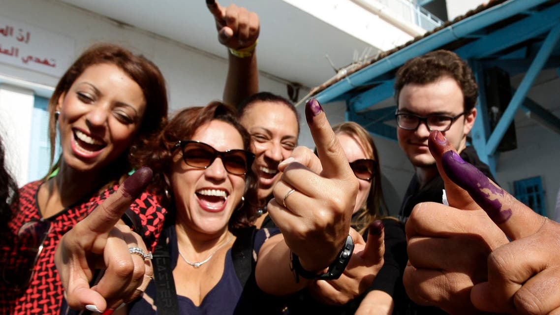 Tunisians show their ink-stained fingers after casting their votes, in Tunis October 26, 2014. (Reuters)