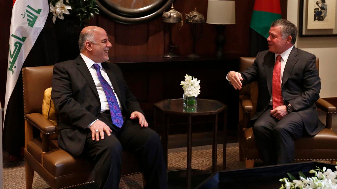 Jordan's King Abdullah (R) laughs with Iraq's Prime Minister Haider al-Abadi during their meeting at the Royal Palace in Amman October 26, 2014. (Reuters)