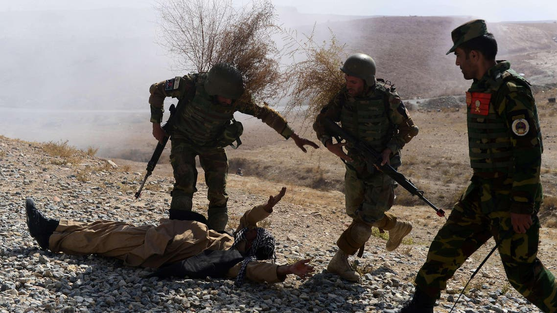 Afghan National Army (ANA) solders arrest a fake Taliban fighter as they take part in a training exercise at the Afghan National Military training center (KMTC) in Kabul on Oct. 22, 2014. (AFP)