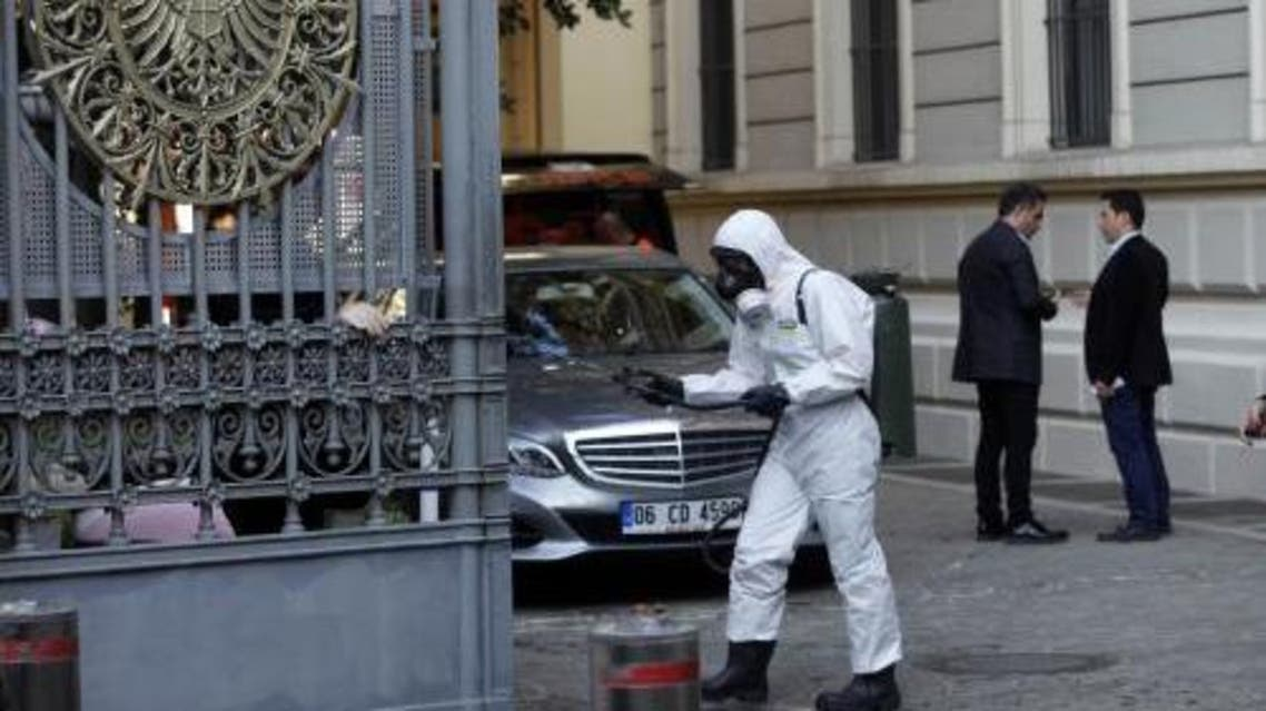 A member of Turkey's disaster management agency disinfects the garden of the German consulate in Istanbul October 24, 2014. (Reuters)