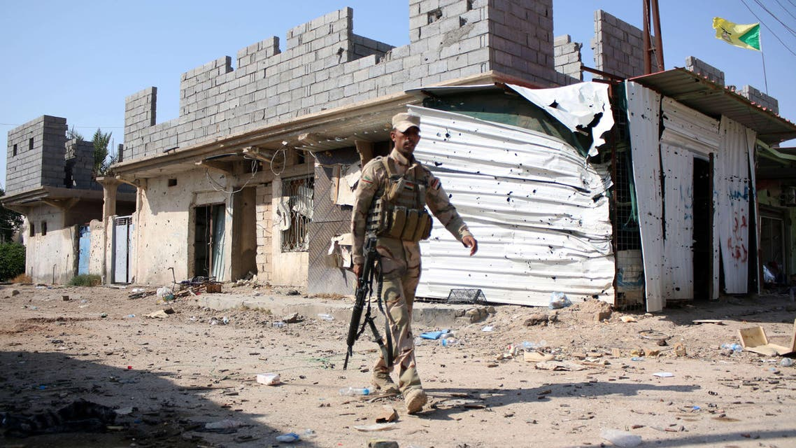 An Iraqi soldier walks in Jurf al-Sakhr on October 27, 2014 after Iraqi military forces retook the large area south of the capital from ISIS. (AFP)