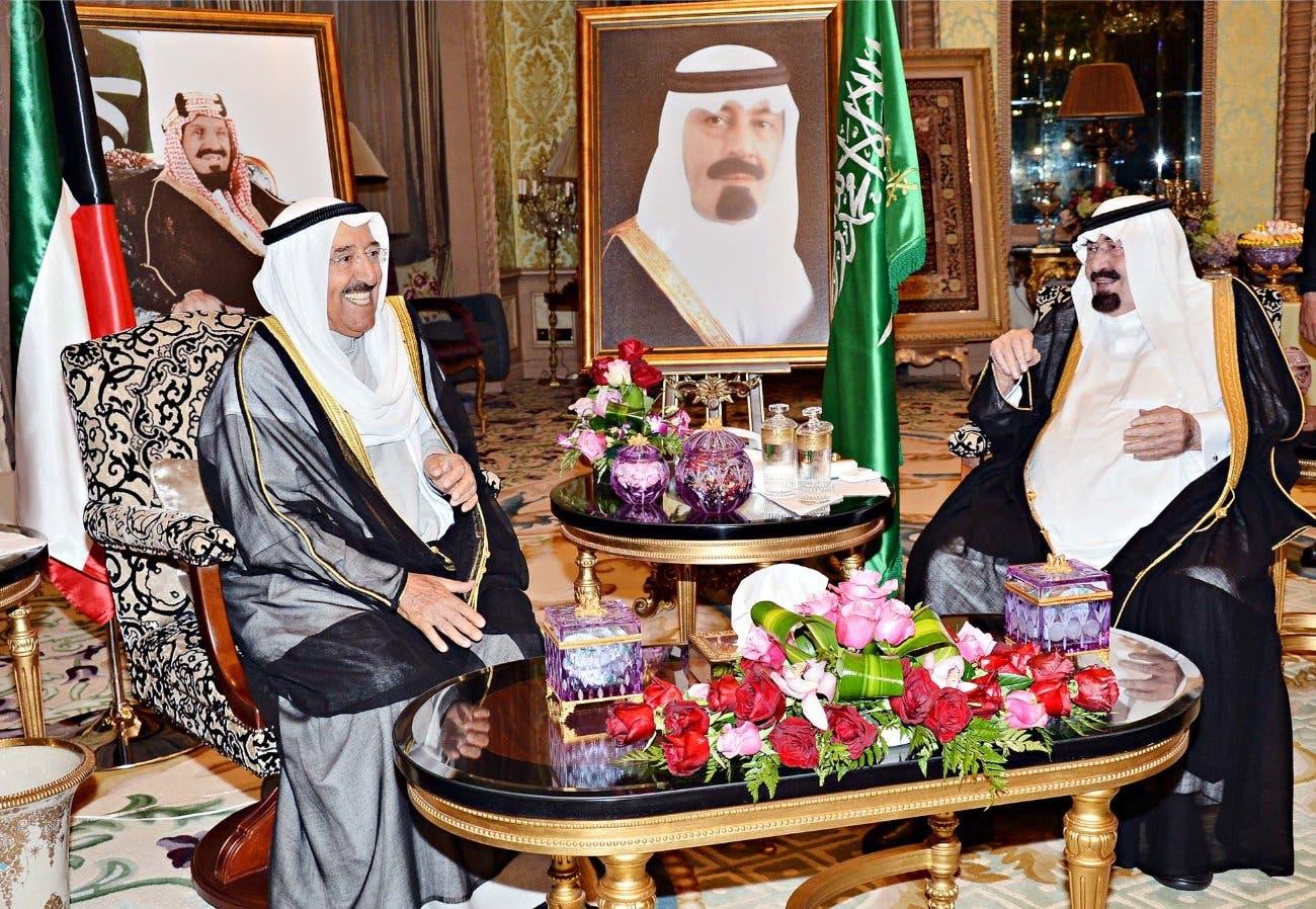 Then-Saudi Arabian King Abdullah (right) with visiting Kuwait emir, Sheikh Sabah al-Ahmad al-Sabah, in 2014. (SPA)