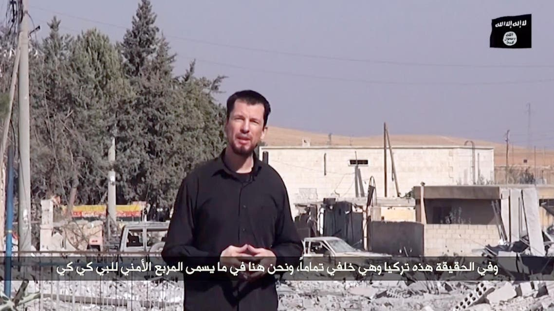 An image grab taken from a video released by ISIS via Youtube on October 27, 2014 purportedly shows 43-year-old kidnapped British reporter John Cantlie. (AFP)