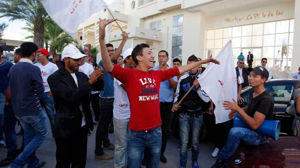 Tunisian rivals both  celebrate election results
