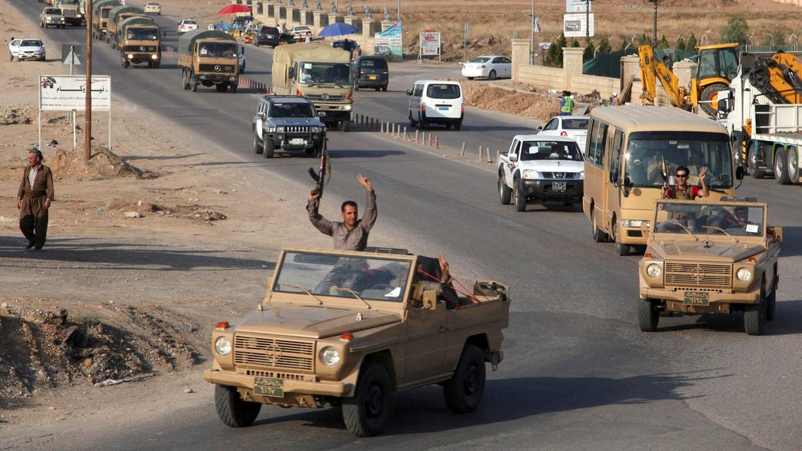 A convoy of Kurdish peshmerga fighters drive through Arbil after leaving a base in northern Iraq, on their way to the Syrian town of Kobani, Oct. 28, 2014.  (AFP)