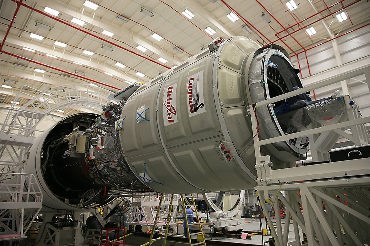 Orbital Sciences Corp. completes a final cargo load of the Cygnus cargo spacecraft in preparation for launch to the International Space Station on October 23, 2014. (Reuters)