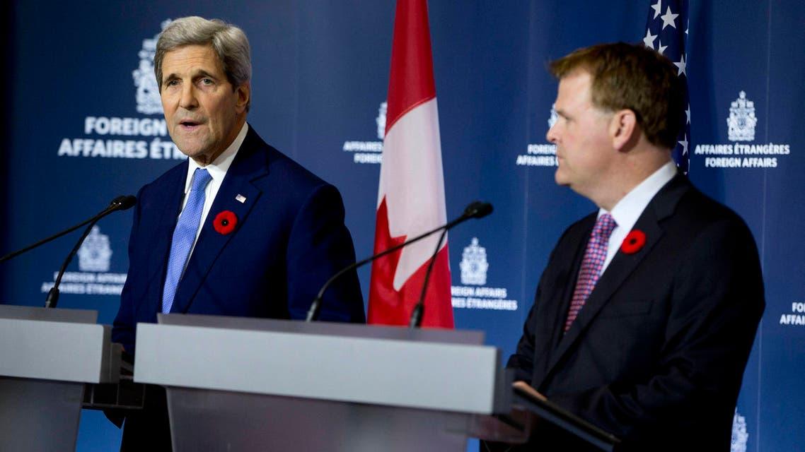 جون كيري وجون بيرد خلال مؤتمر صحافي في كندا