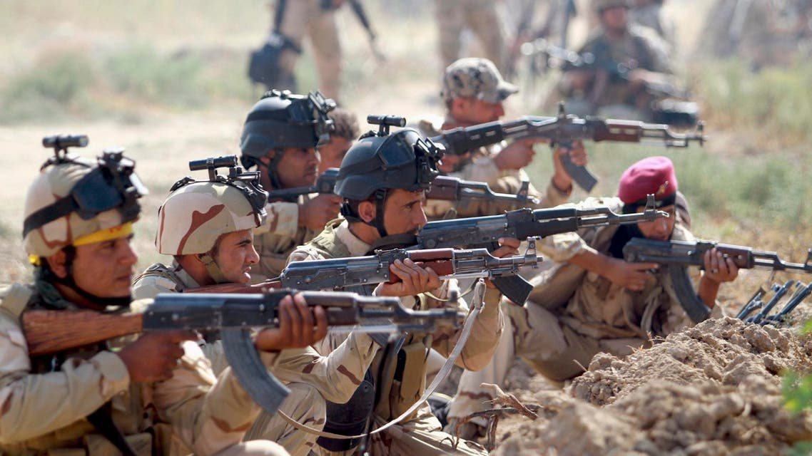 Iraqi Army personnel take part during an intensive security deployment against Islamic State militants in Jurf al-Sakhar October 27, 2014. (Reuters)