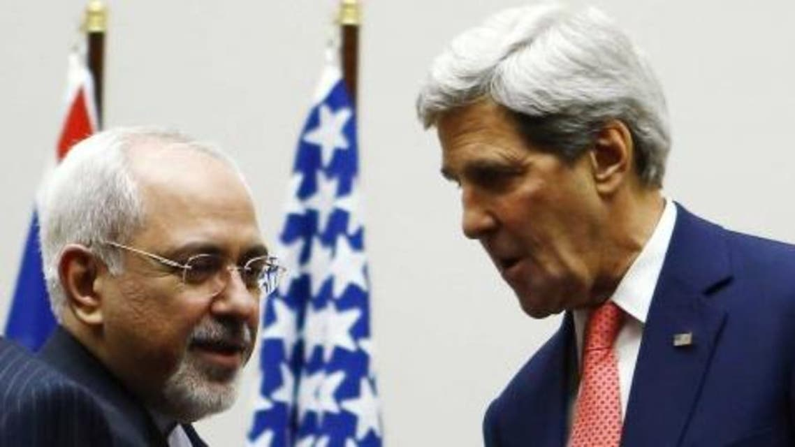 U.S. Secretary of State John Kerry (R) shakes hands with Iranian Foreign Minister Mohammad Javad Zarif after a ceremony at the United Nations in Geneva November 24, 2013. (Reuters)