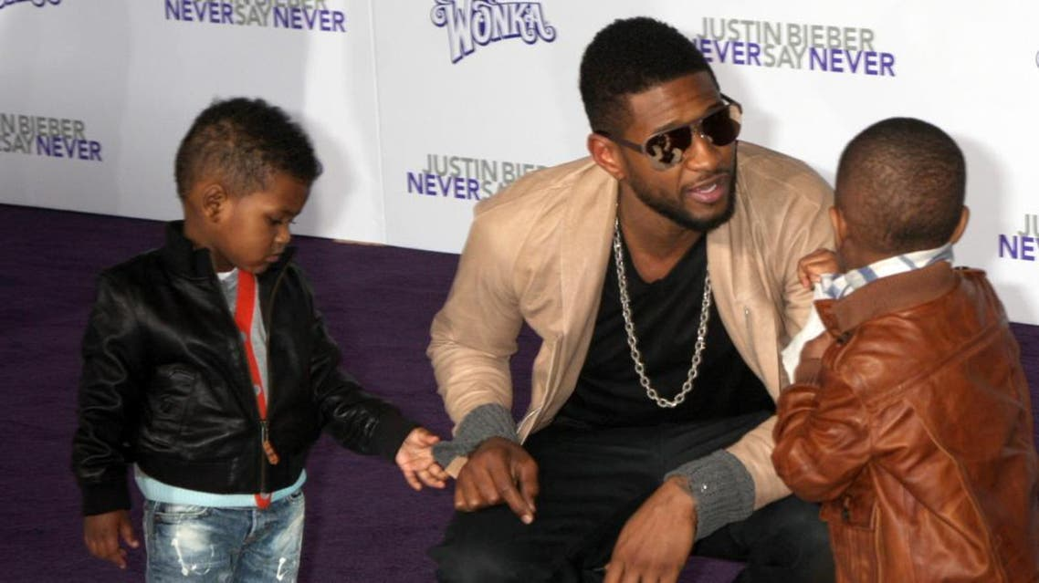 Usher and his sons (Shutterstock)