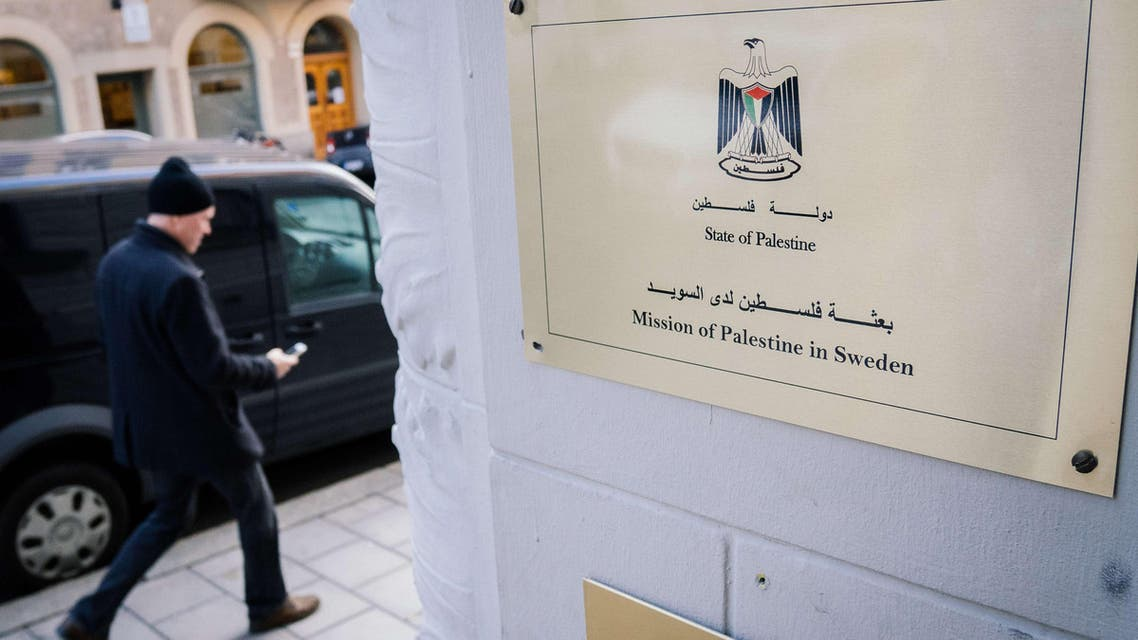 A man walks by the entrance of the Palestinian Representative Office in Stockholm, Sweden 's capital, on Oct. 30, 2014. (Reuters)