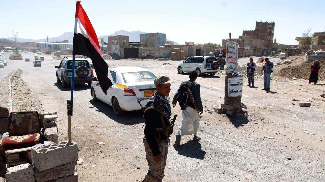 Yemeni gunmen loyal to the Shiite Houthi movement man a checkpoint in Sanaa. (AFP)
