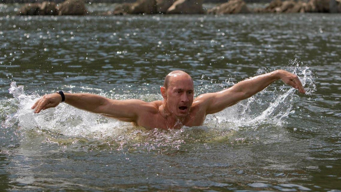 Vladimir Putin swims in a Siberian lake. (Photograph: Ria Novosti/Reuters)