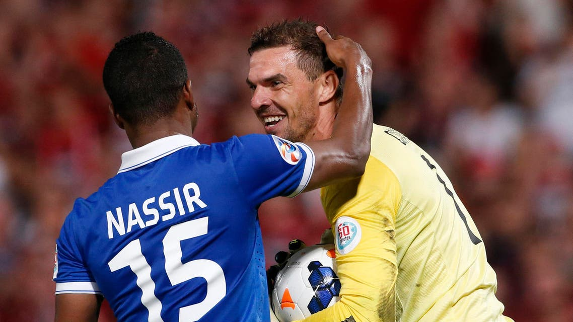 Western Sydney Wanderers goalkeeper Ante Covic (R) reacts as Nassir Alshamrani of Saudi Arabia's Al-Hilal touches him during their Asian Champions League final first-leg soccer match at Parramatta Stadium in Sydney October 25, 2014.
