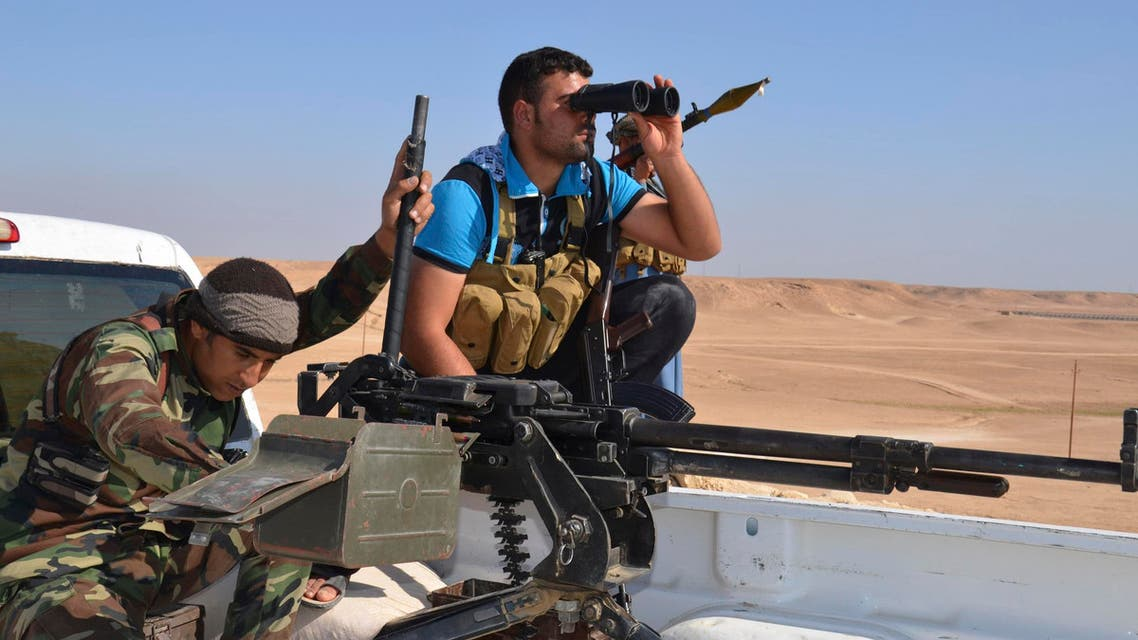 Tribal fighters take part in an intensive security deployment against Islamic State militants in Haditha October 25, 2014.  (Reuters)