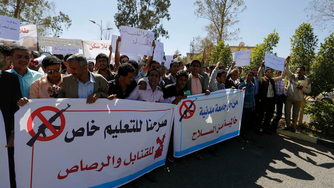 Students hold banners to demonstrate against the deployment of armed Houthi gunmen, at Sanaa University campus in Sanaa October 29, 2014. (Reuters)