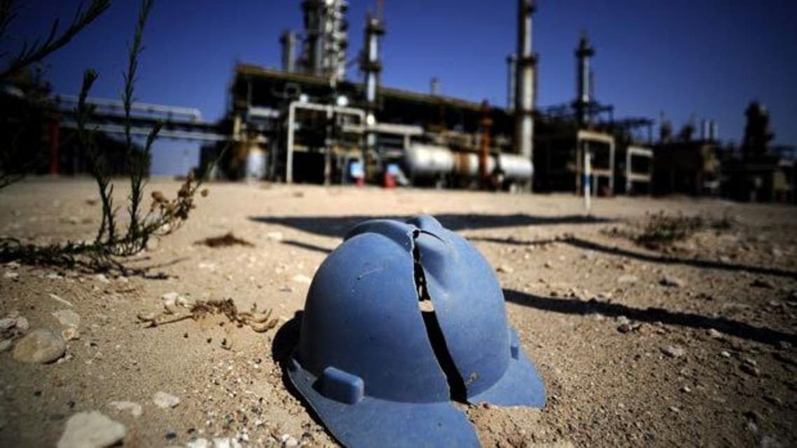A worker's helmet lies on the ground at the Zawiya oil refinery, some 40 kms west of Tripoli. afp