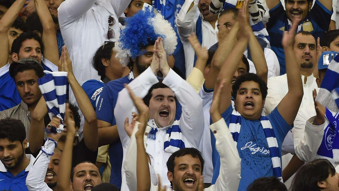 Fans of Saudi Arabia's Al Hilal cheer during a match against Australia's Western Sydney Wanderers in the AFC Champions League final football match at King Fahad stadium in Riyadh city on November 1, 2014.  (AFP)