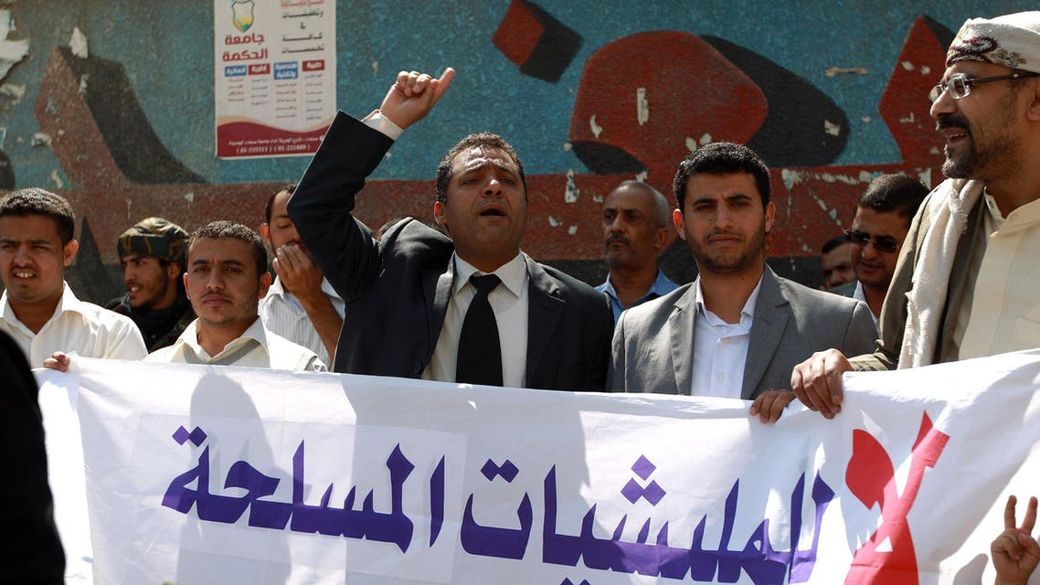Yemeni activists shout slogans during a rally in Sanaa, on November 1, 2014, against the control by Shiite Huthi fighters on the country's main cities.  (AFP)
