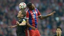Bayern hold on to power despite Dortmund test
